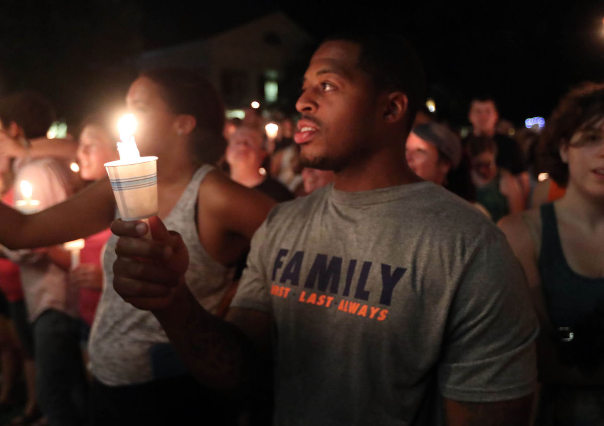 People hold a candle-light vigil on August 16, 2017 in Charlottesville